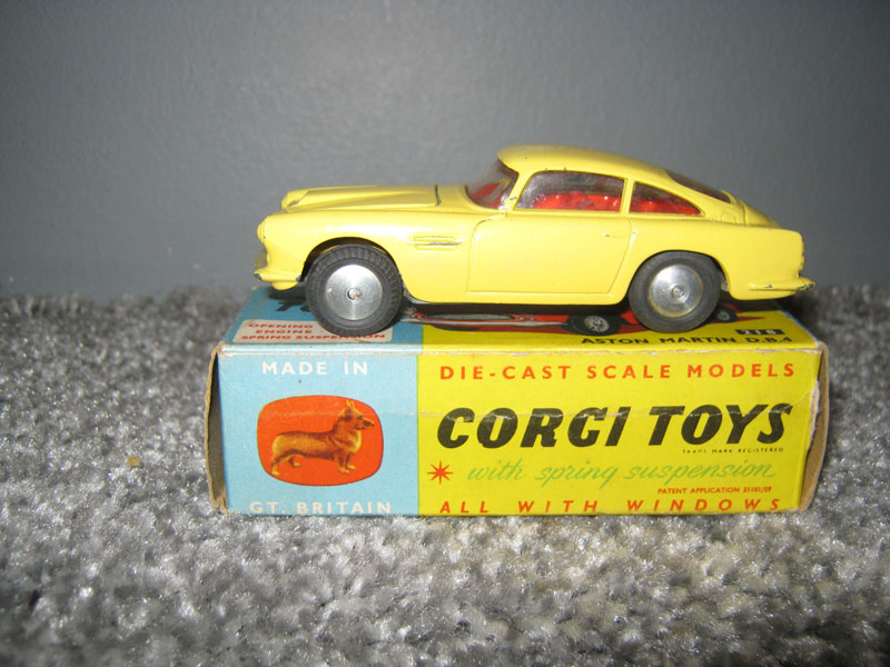 Corgi Toys 218 Aston Martin D.B.4. Primrose Yellow Body with Bonnet Vent, Red Interior