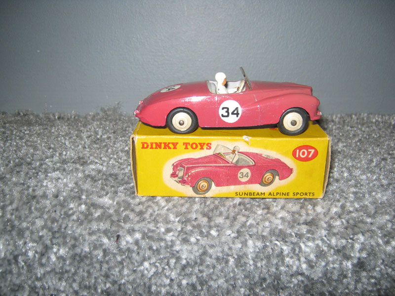 Dinky Toys 107 Sunbeam Alpine Sports Deep Pink Body Grey Interior Cream Hubs, R/N 34, White Racing Driver