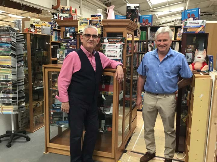 Grant and Adrian with Collectables in Glass Cabinets